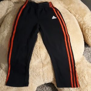Adidas red and black sweat pants